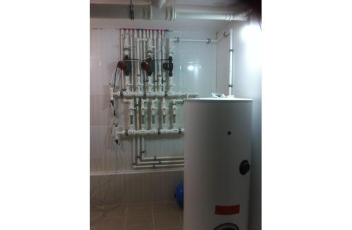 Установка электрокотлов. Монтаж сантехнических систем (отопление, водопровод, канализация), фото — «Реклама Севастополя»