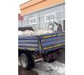 Вывоз строительного мусора с погрузкой, демонтаж, доставка сыпучих материалов в Симферополе - Строительные работы в Крыму