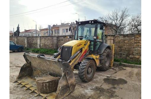 Аренда  экскаватора-погрузчика в Севастополе Профессионально - Услуги в Севастополе